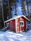 Sauna in the winter. Wooden red sauna building in snowy landscape Stock Images