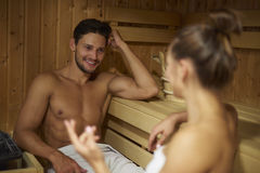 Sauna. Young couple spending time in the sauna royalty free stock photo