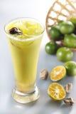 Saurer Pflaumesaft der Zitrusfrucht Lizenzfreie Stockfotos