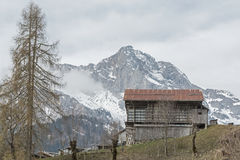 Sauris di sopra in Friuli. Sauris, German Zahr is a village,  where German is still spoken today. The building is characterized by peculiar wooden houses and Stock Image