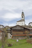 Sauris di sotto with the Church of the Holy Oswald. Sauris to German Zahre is a village in the Carinthian Alps, where is spoken German today Royalty Free Stock Image