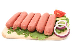 Sausage. Fresh sausages isolated on white Royalty Free Stock Photography