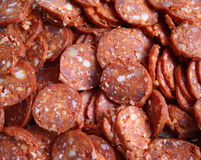Sausage. Lots of cut and fresh sausages royalty free stock images