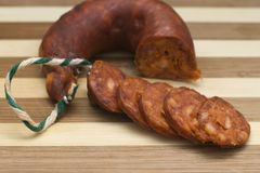 Sausage. Smoked sausage on a wooden board Stock Photo