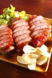 Sausage. Sliced sausage on the dish Stock Photos