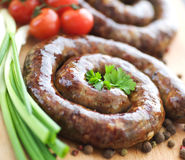 Sausage. Tasty Grilled Sausage and vegetables.Selective focus stock photos