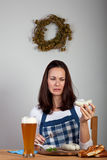 Sausage. Girl in an apron and a bavarian sausage Stock Photo