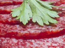 Sausage. Three pieces of smoked sausage Stock Photo