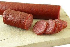 Sausage. Dried sausage arranged on wooden cutting board Royalty Free Stock Photos