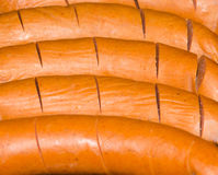 Sausage. Sliced up sausage in pan Stock Photos