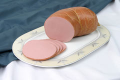 Sausage. Boiled sausage on a plate Stock Image