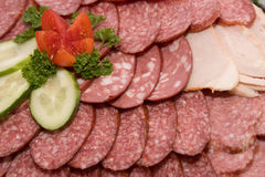 Sausage. Different sausages arranged on a plate to feed on the table stock photo