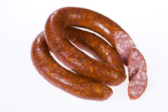 Sausage. Piece of sausage on isolated background stock images