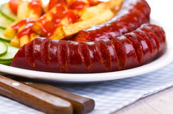 Sausage And French Fries Royalty Free Stock Photography