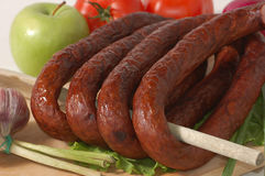 Sausage, apple and tomatoes Royalty Free Stock Photography
