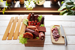 Sausage assortment and sliced salami on wood Stock Photography