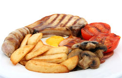 Sausage, bacon tomato and egg breakfast Royalty Free Stock Image