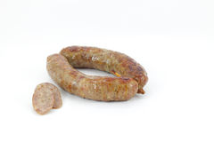 Sausage baked and sliced on white,  Stock Photo
