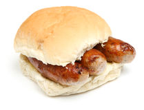 Sausage Bap or Roll Sandwich on White Royalty Free Stock Photo