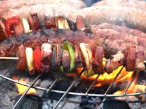 Sausage and barbecue. On grill stock photography