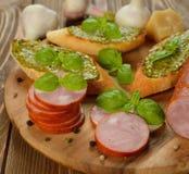 Sausage with basil Royalty Free Stock Image