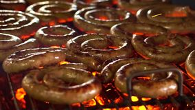 Sausage BBQ with fire and charcoal stock footage