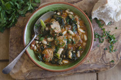 Sausage, bean and kale stew Stock Images