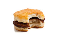 Sausage biscuit with a bite out on white Royalty Free Stock Photos