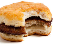 Sausage biscuit with a bite out on white Stock Image