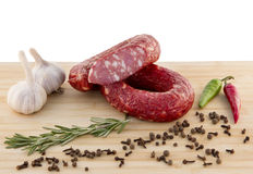 Sausage on a board Stock Photos