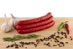 Sausage on a board Royalty Free Stock Images
