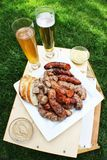 Sausage, bread and beer Stock Photos