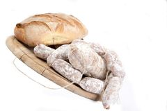 Sausage and bread on cutting board Royalty Free Stock Photography