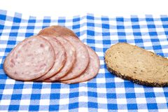 Sausage with bread on napkin Royalty Free Stock Photos
