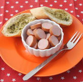 Sausage with bread Stock Images