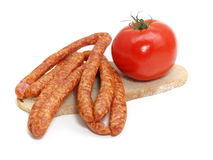 Sausage with bread and vegetables Stock Photos