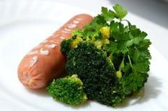 Sausage and broccoli stock photography