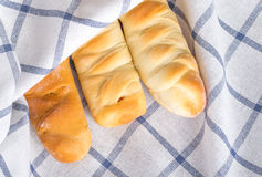 Sausage buns in white gingham fabric Stock Images