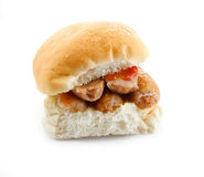 Sausage Butty. Sausage filled bread roll, bap or bun Stock Images