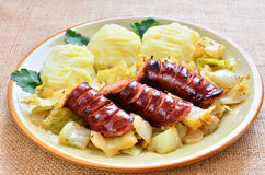 Sausage with cabbage Stock Photos
