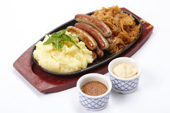 Sausage with cabbage Stock Images