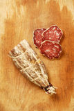 Sausage of campaign. Pig sausage and slices cut on a wooden board Stock Images