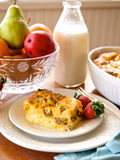 Sausage Cassarole. With milk bottle, and crystal bowl of fruit Royalty Free Stock Image