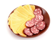 Sausage and cheese on plate isolated Stock Photography