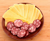 Sausage and cheese on plate isolated Royalty Free Stock Photo