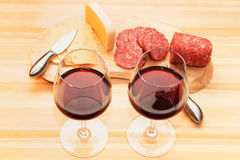 Sausage cheese and wine. On a wooden table stock image