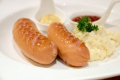 Sausage with chili sauce in white plate Royalty Free Stock Images