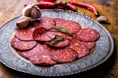 Sausage Chorizo. Spanish traditional chorizo sausage, with fresh herbs, garlic, pepper and chili peppers. Traditional cuisine Royalty Free Stock Image