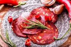 Sausage Chorizo. Spanish traditional chorizo sausage, with fresh herbs, garlic, pepper and chili peppers. Traditional cuisine Royalty Free Stock Photo