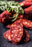 Sausage Chorizo. Spanish traditional chorizo sausage, with fresh herbs, garlic, pepper and chili peppers. Traditional cuisine Royalty Free Stock Photos